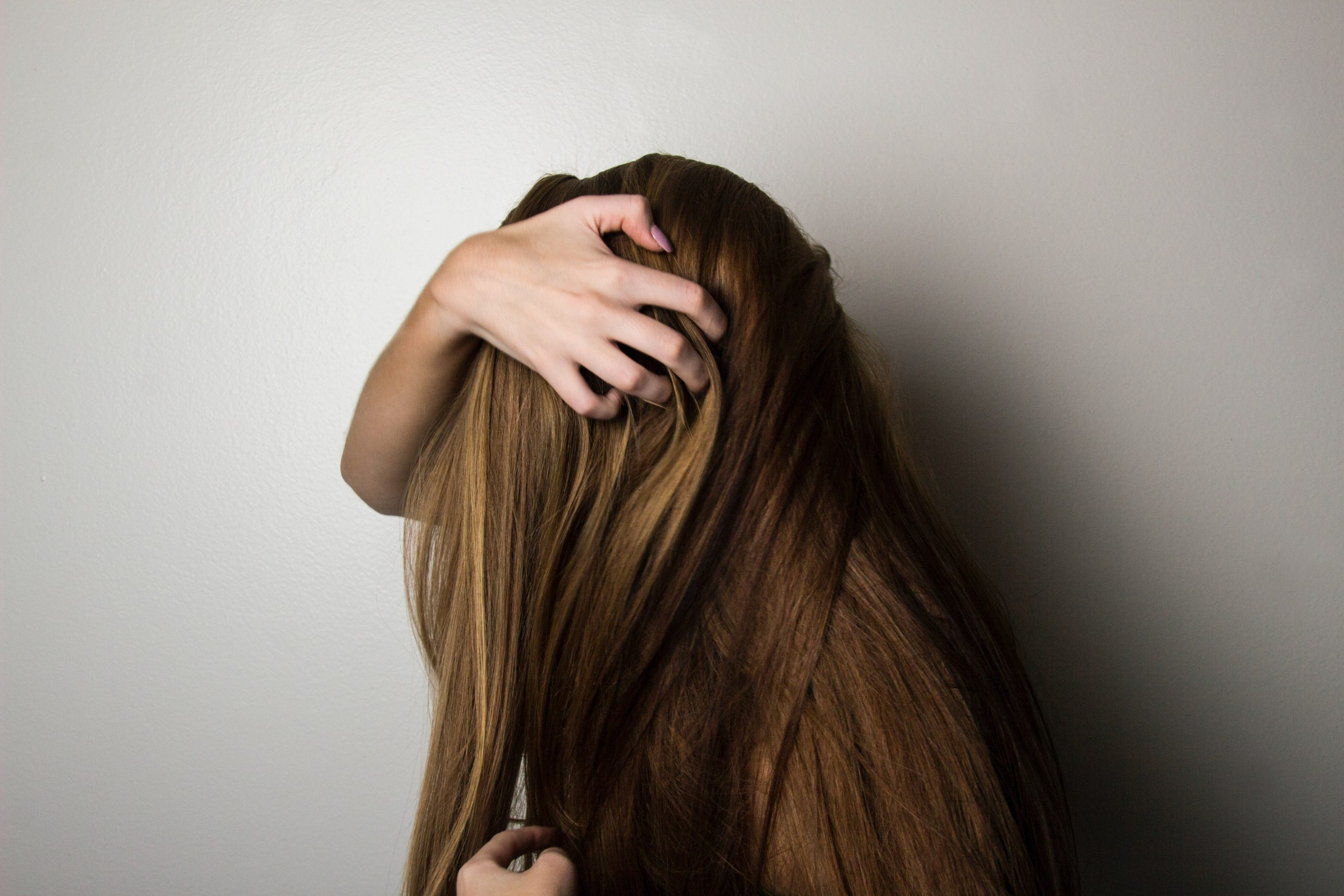 woman running fingers through her hair